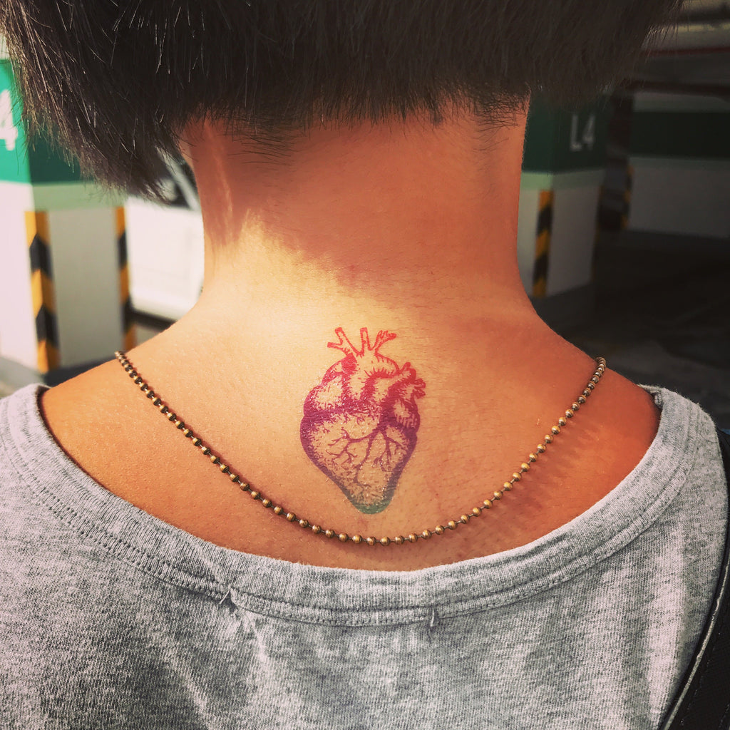 fake small rainbow anatomical heart color temporary tattoo sticker design idea on neck