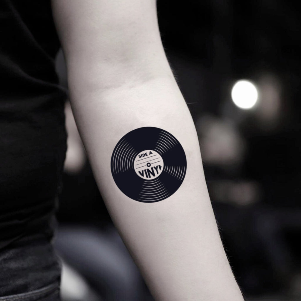 fake small record edm vintage temporary tattoo sticker design idea on inner arm