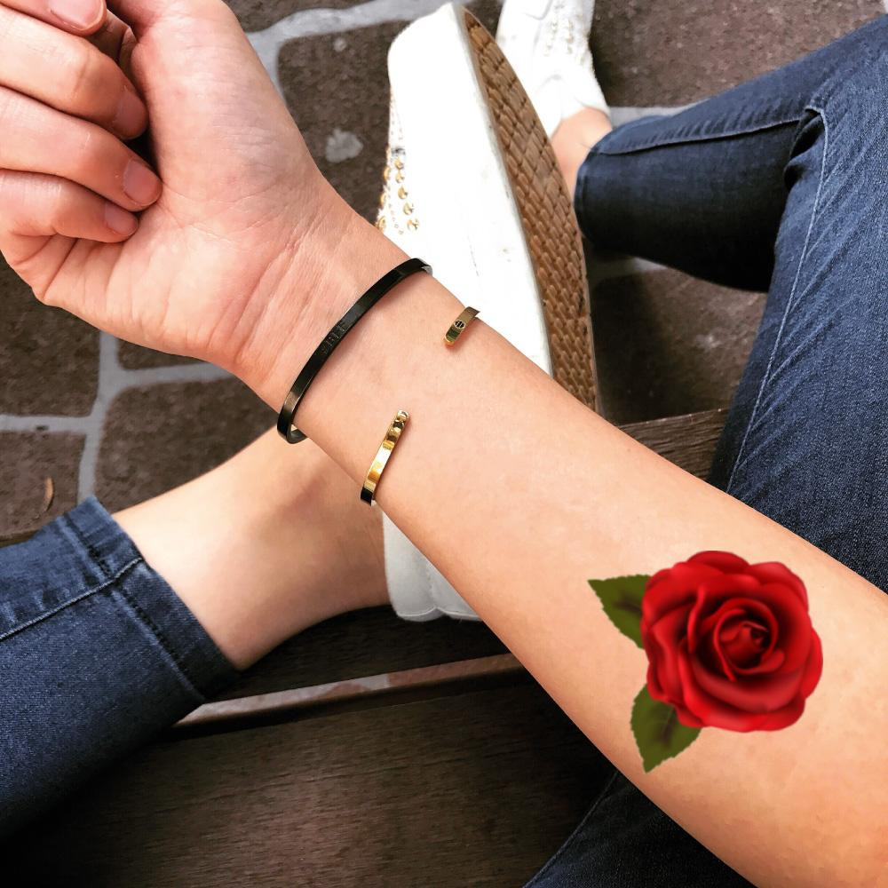 fake small red rose petal flower color temporary tattoo sticker design idea on forearm