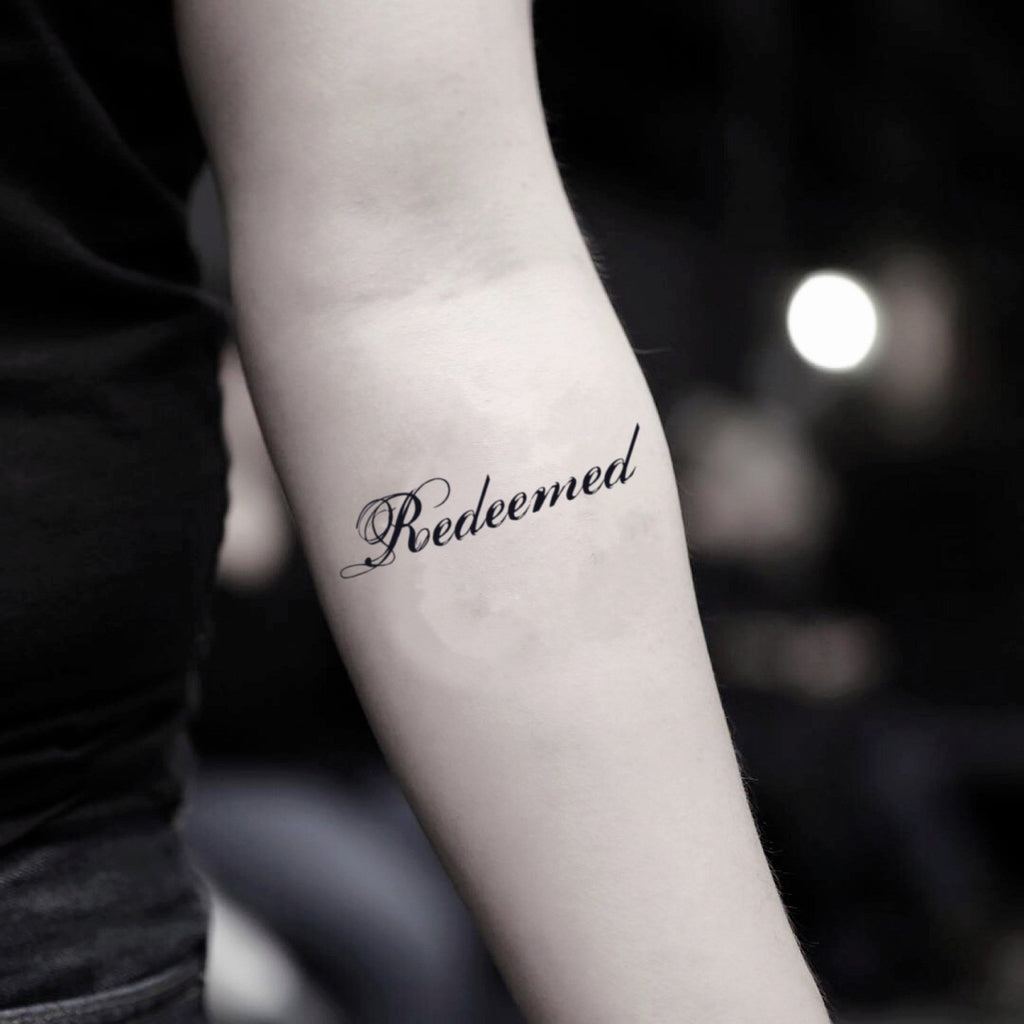 fake small redeemed lettering temporary tattoo sticker design idea on inner arm