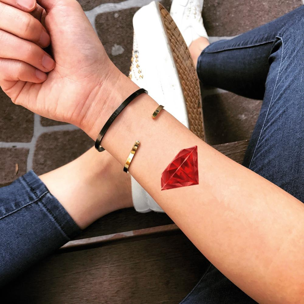 fake small ruby red diamond color jewel temporary tattoo sticker design idea on wrist