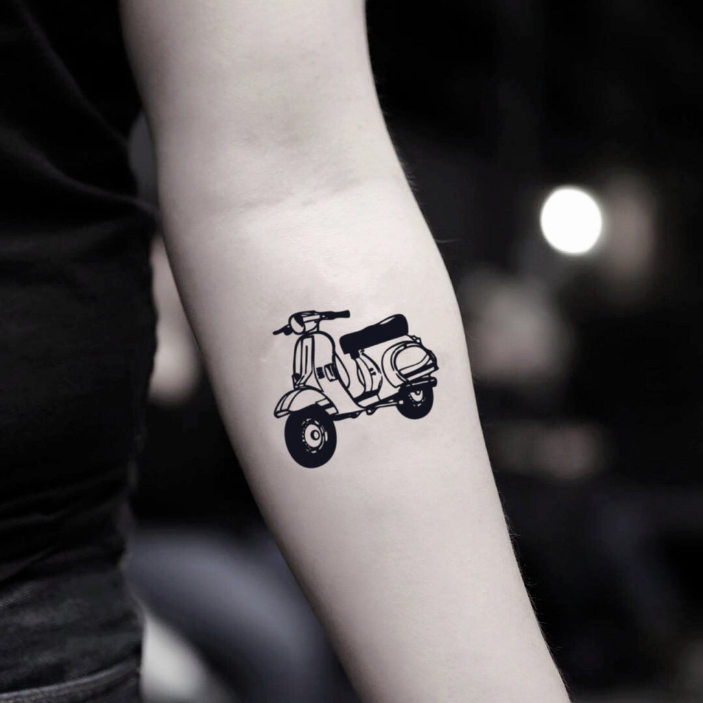 fake small scooter illustrative temporary tattoo sticker design idea on inner arm
