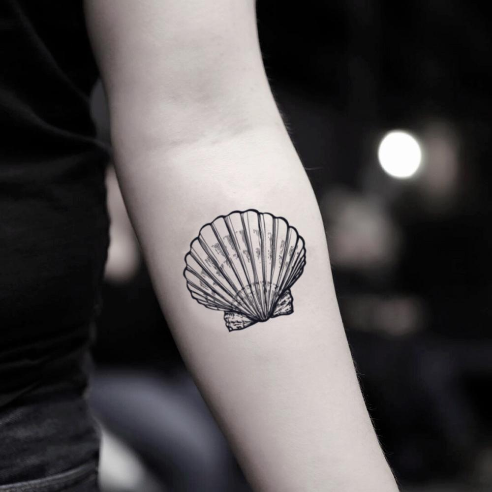 fake small concha seashell scallop shell illustrative temporary tattoo sticker design idea on inner arm