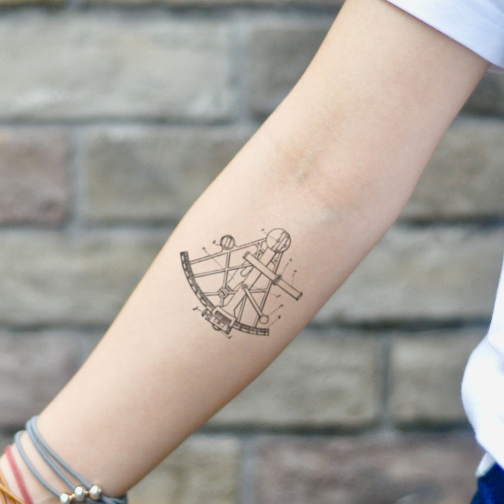 fake small sextant nautical geometric temporary tattoo sticker design idea on inner arm