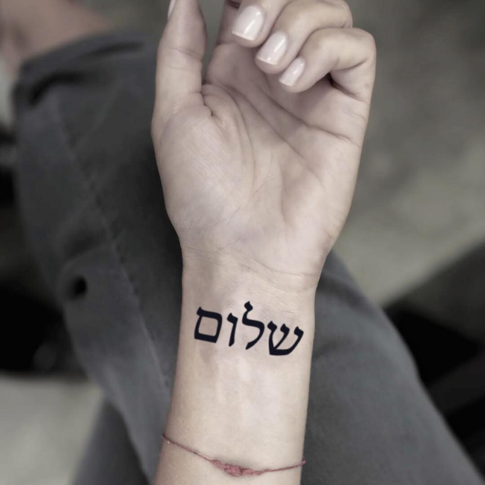 fake small shalom christian hebrew writing lettering temporary tattoo sticker design idea on wrist