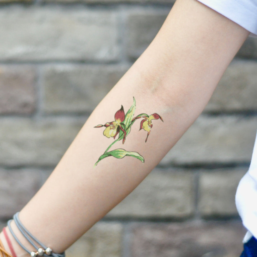 fake small showy lady slipper flower temporary tattoo sticker design idea on inner arm