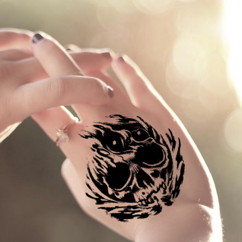fake small evil skull good nice hand illustrative temporary tattoo sticker design idea on wrist