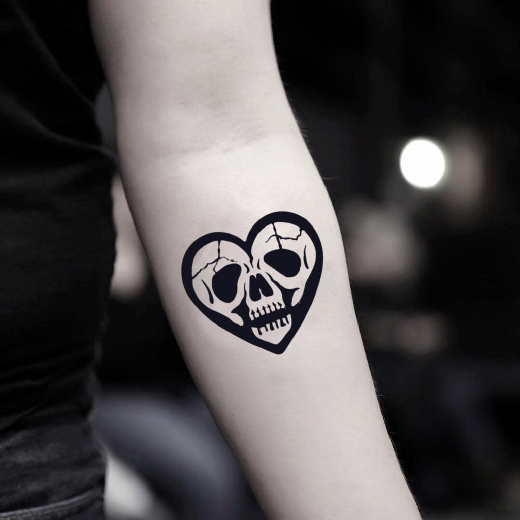 fake small skull heart illustrative temporary tattoo sticker design idea on inner arm