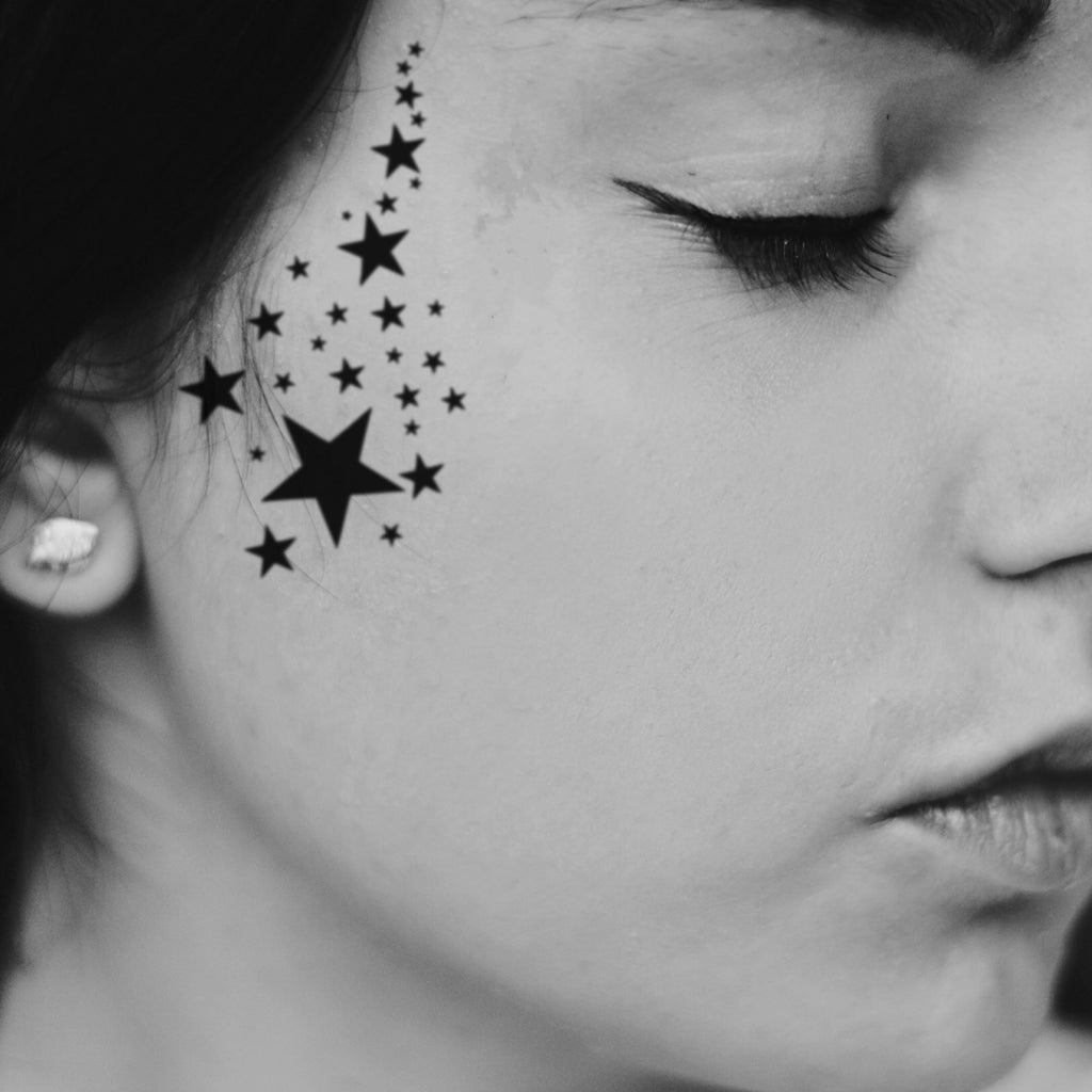 fake small stars minimalist temporary tattoo sticker design idea on face