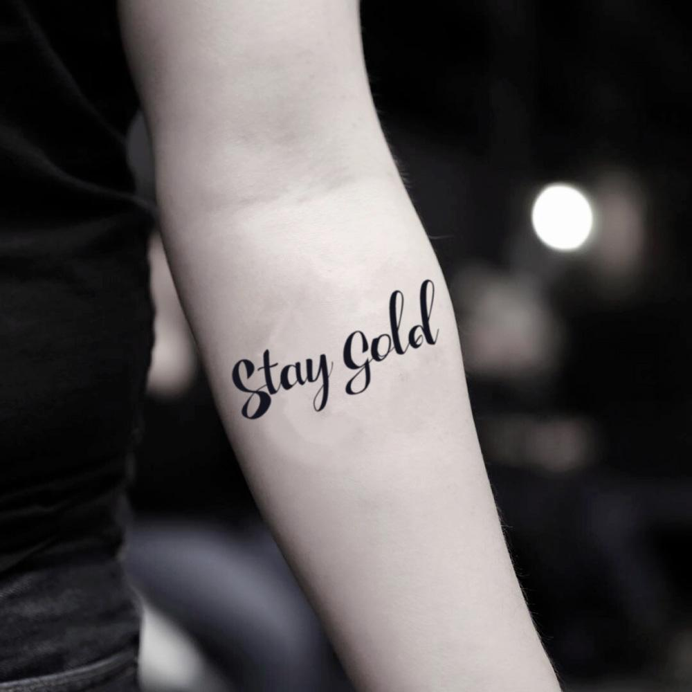fake small stay gold lettering temporary tattoo sticker design idea on inner arm