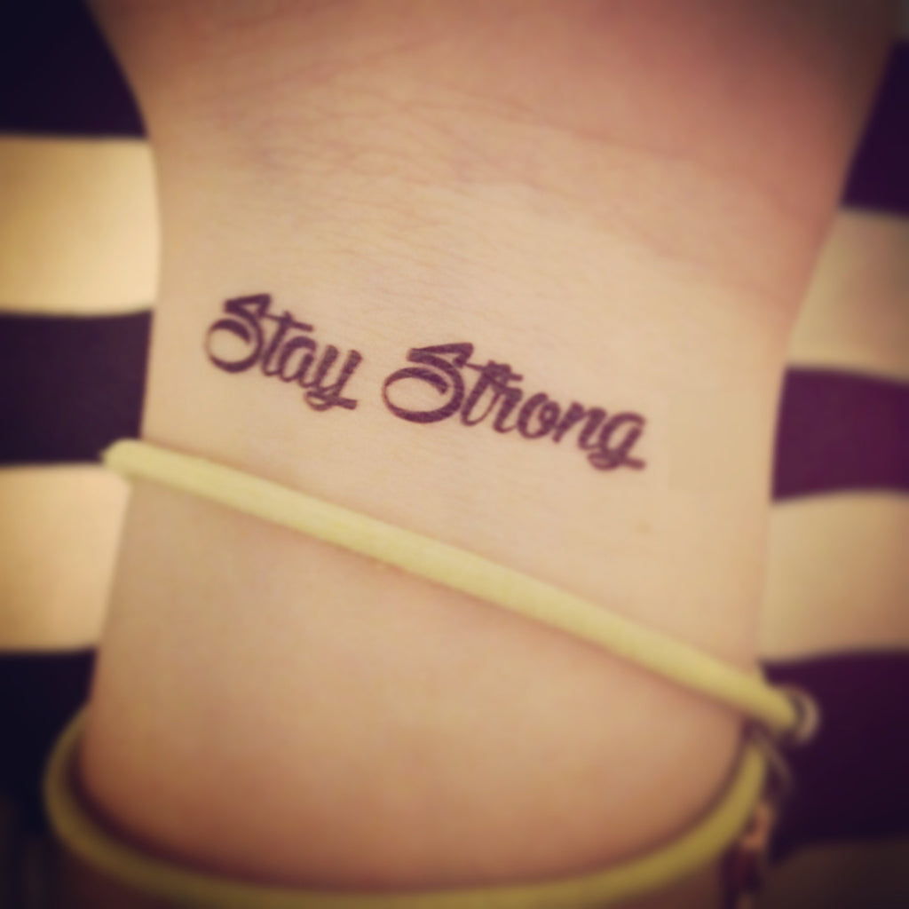 fake small stay strong quote lettering temporary tattoo sticker design idea on wrist