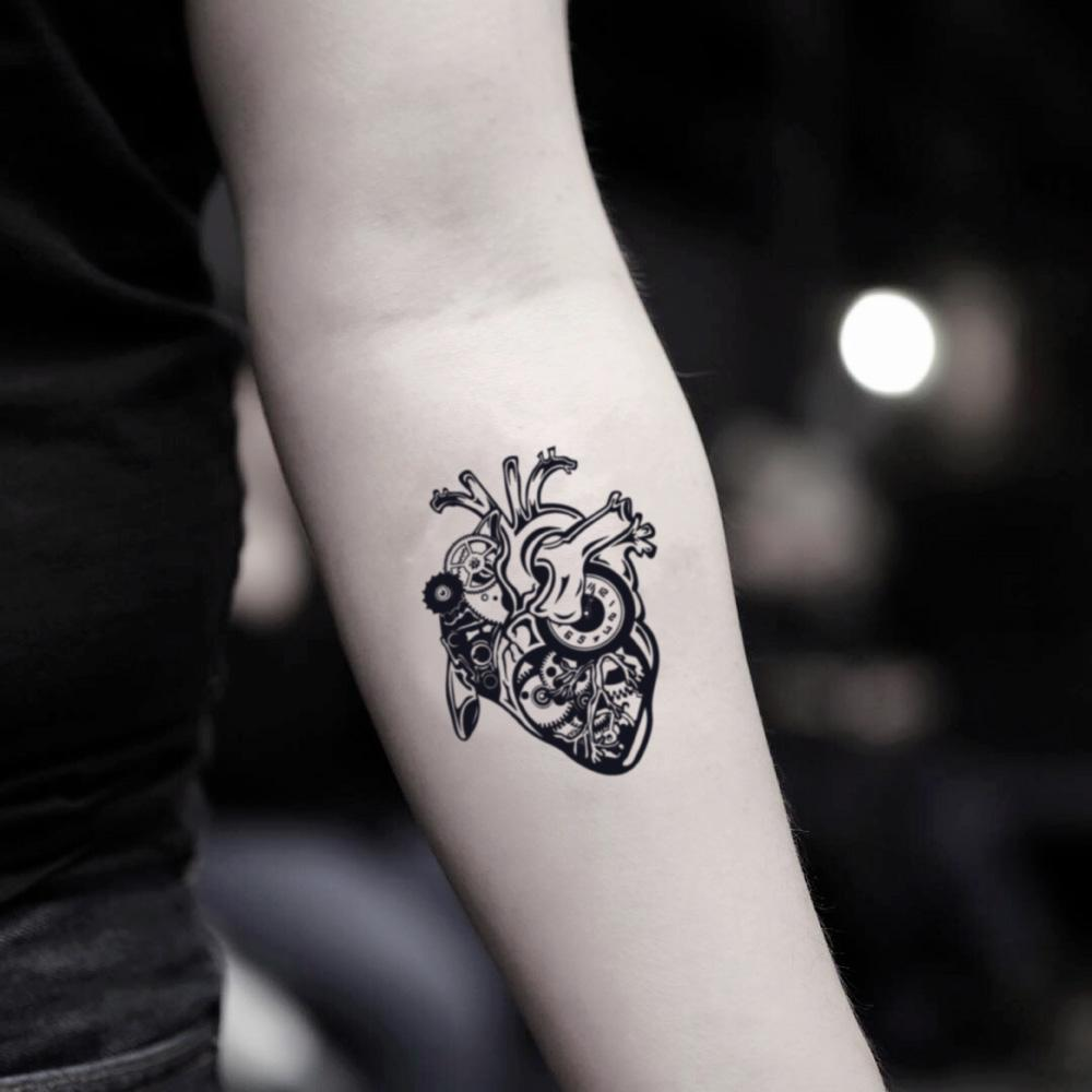 fake small steampunk mechanical heart illustrative temporary tattoo sticker design idea on inner arm