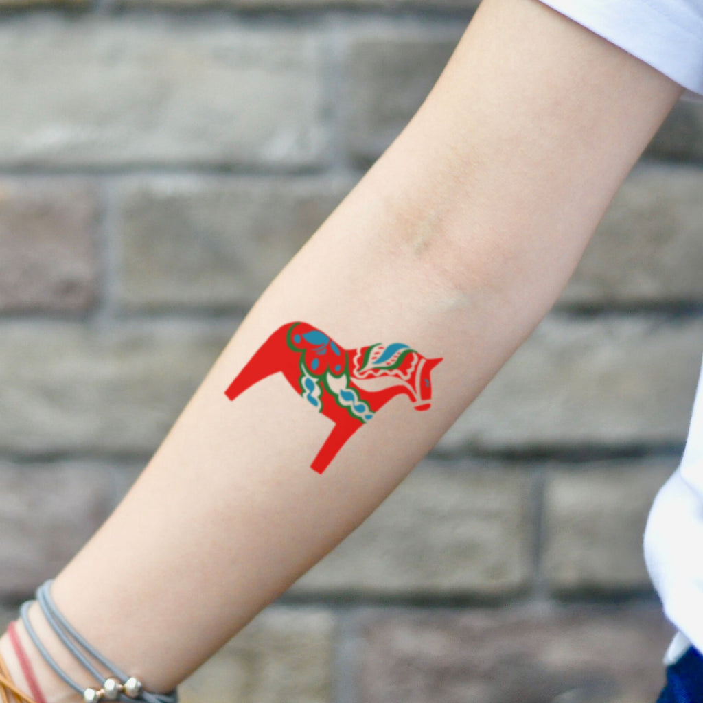 fake small swedish red dala horse folk art color temporary tattoo sticker design idea on inner arm