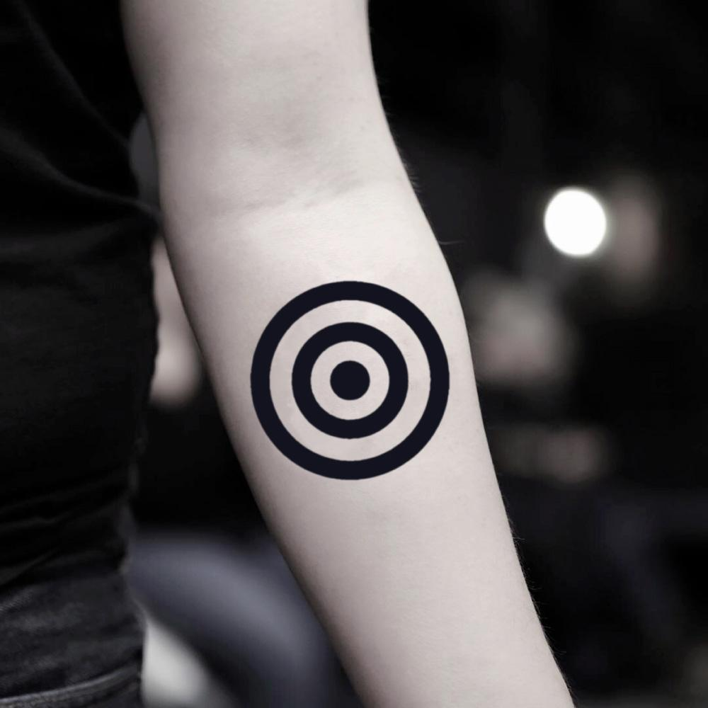 fake small target full circle geometric temporary tattoo sticker design idea on inner arm