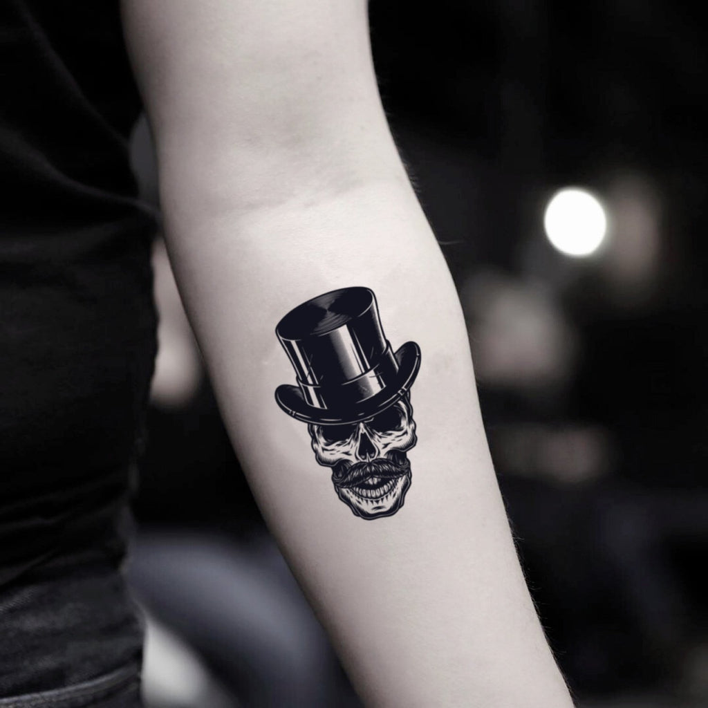 fake small top hat illustrative temporary tattoo sticker design idea on inner arm
