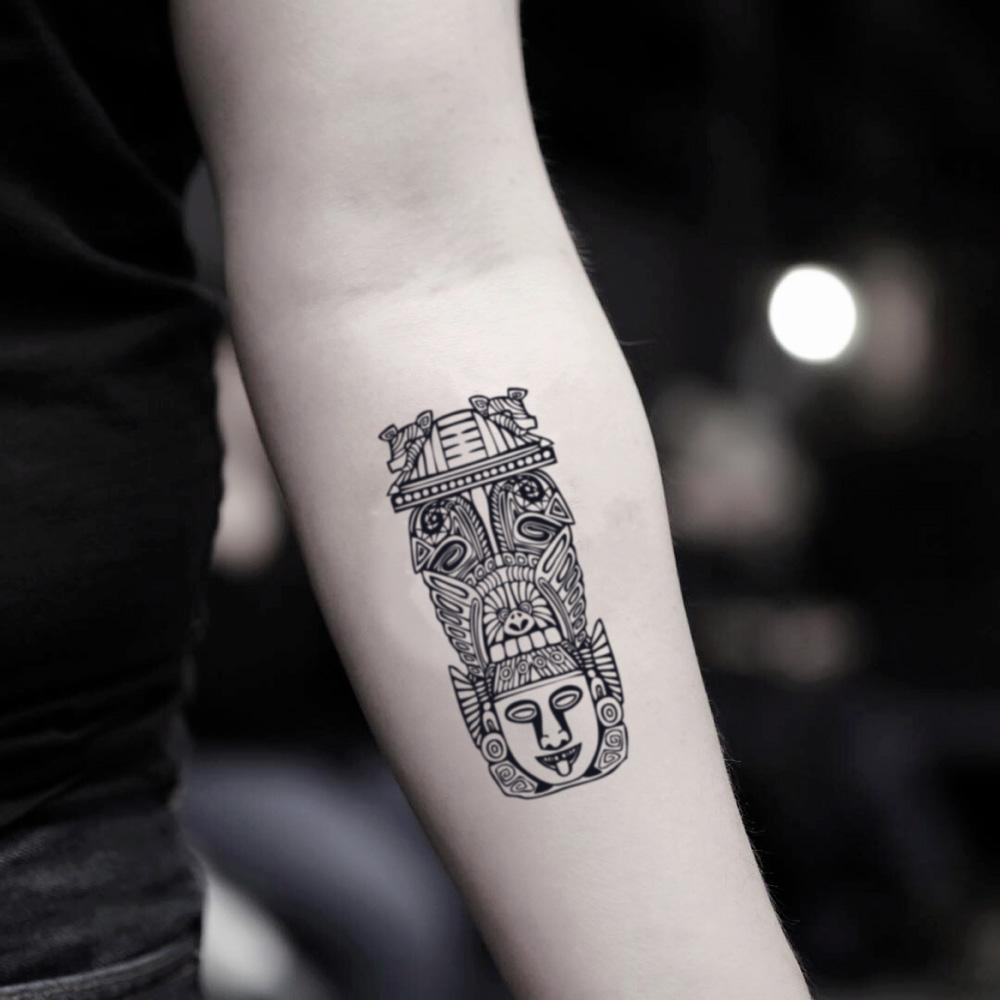 fake small totem pole tribal temporary tattoo sticker design idea on inner arm