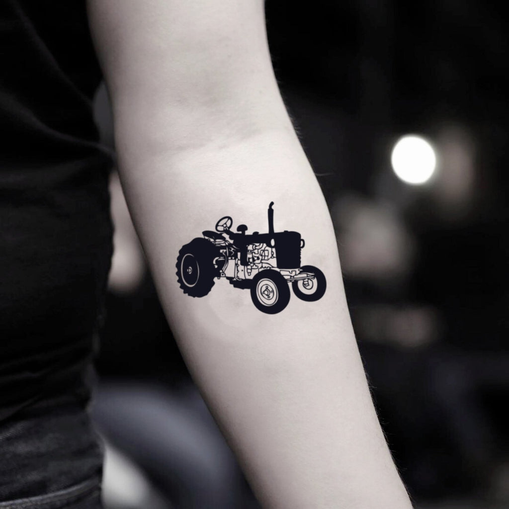 fake small tractor illustrative temporary tattoo sticker design idea on inner arm