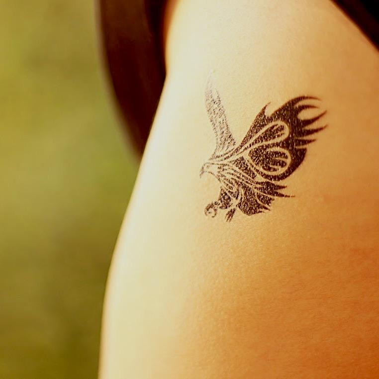 fake small tribal roman eagle animal temporary tattoo sticker design idea on upper arm