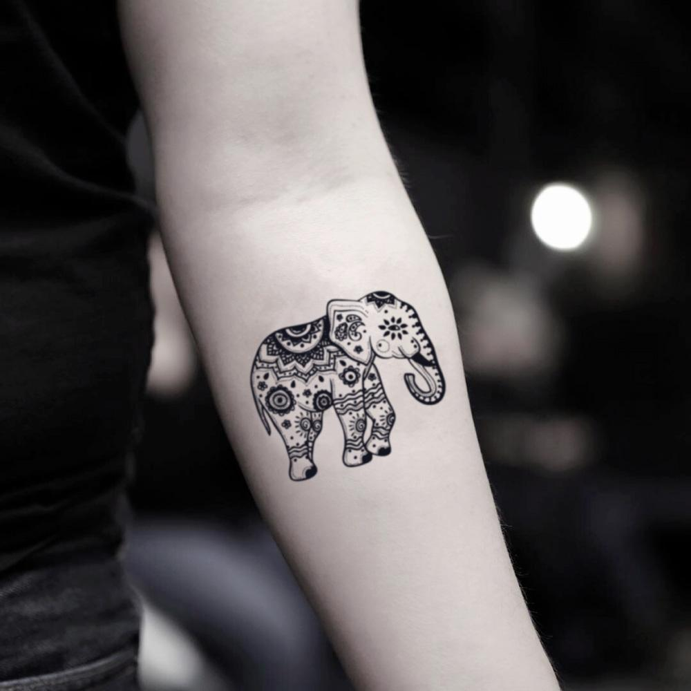 fake small tribal thai elephant animal temporary tattoo sticker design idea on inner arm