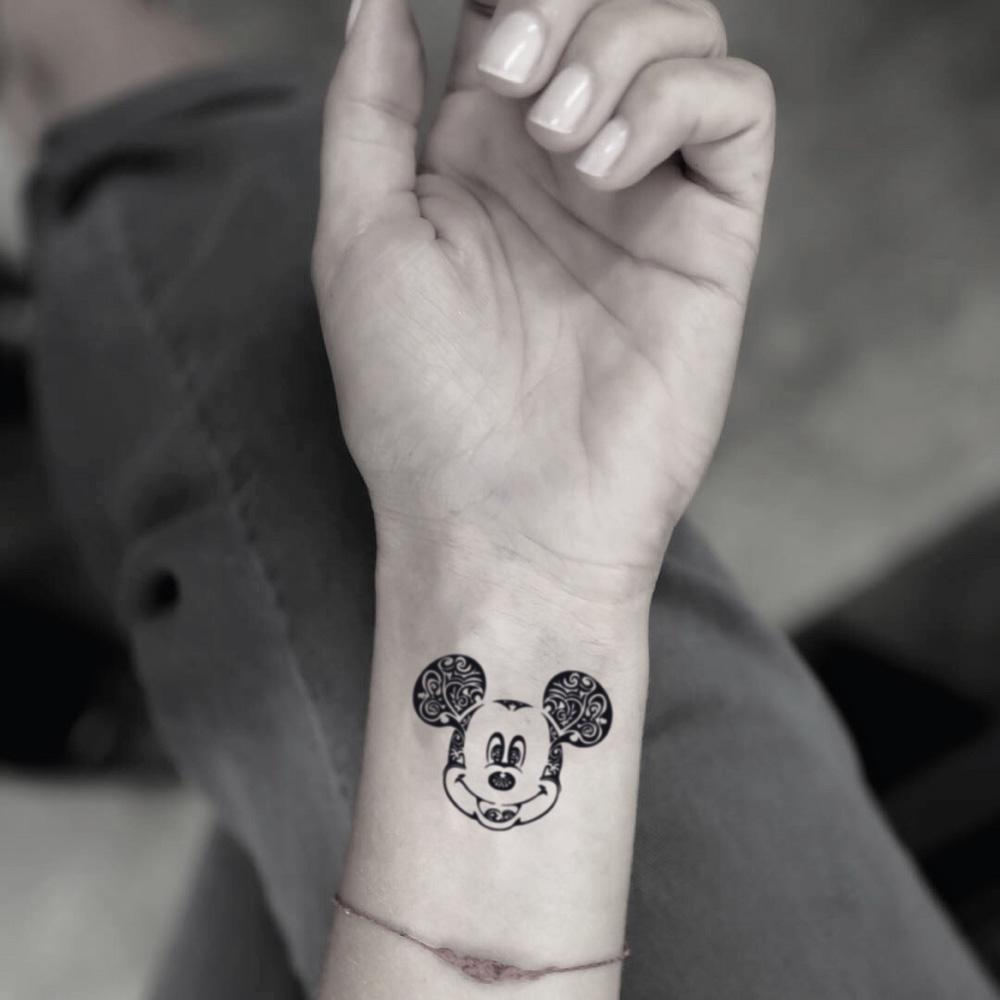 fake small tribal mickey mouse cartoon temporary tattoo sticker design idea on wrist