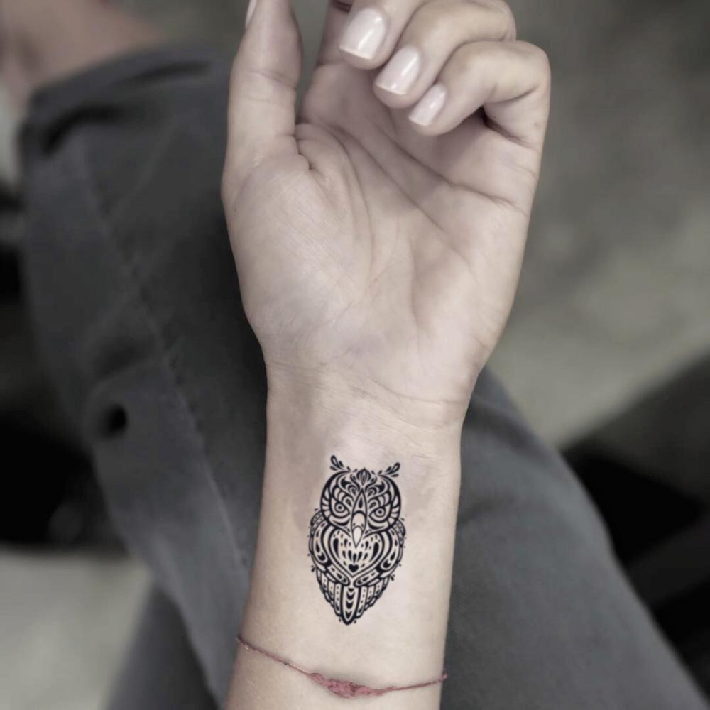 fake small little black and white tribal buho eagle great horned nite night owl head animal temporary tattoo sticker design idea on wrist for girl