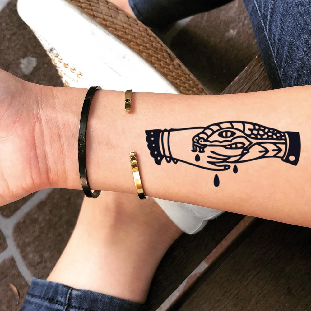fake small trust no one fake friends handshake snake bite trad illustrative temporary tattoo sticker design idea on wrist