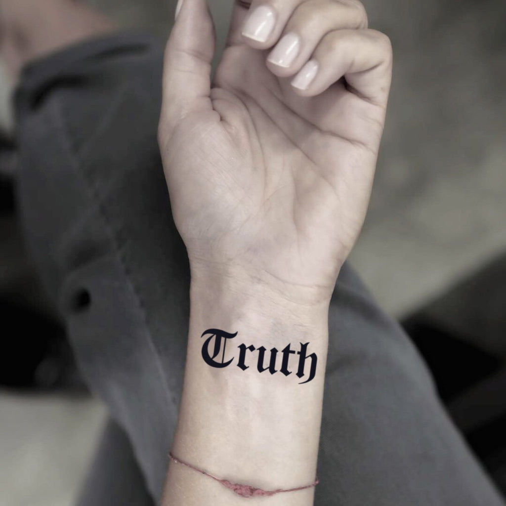 fake small truth gothic font lettering temporary tattoo sticker design idea on wrist