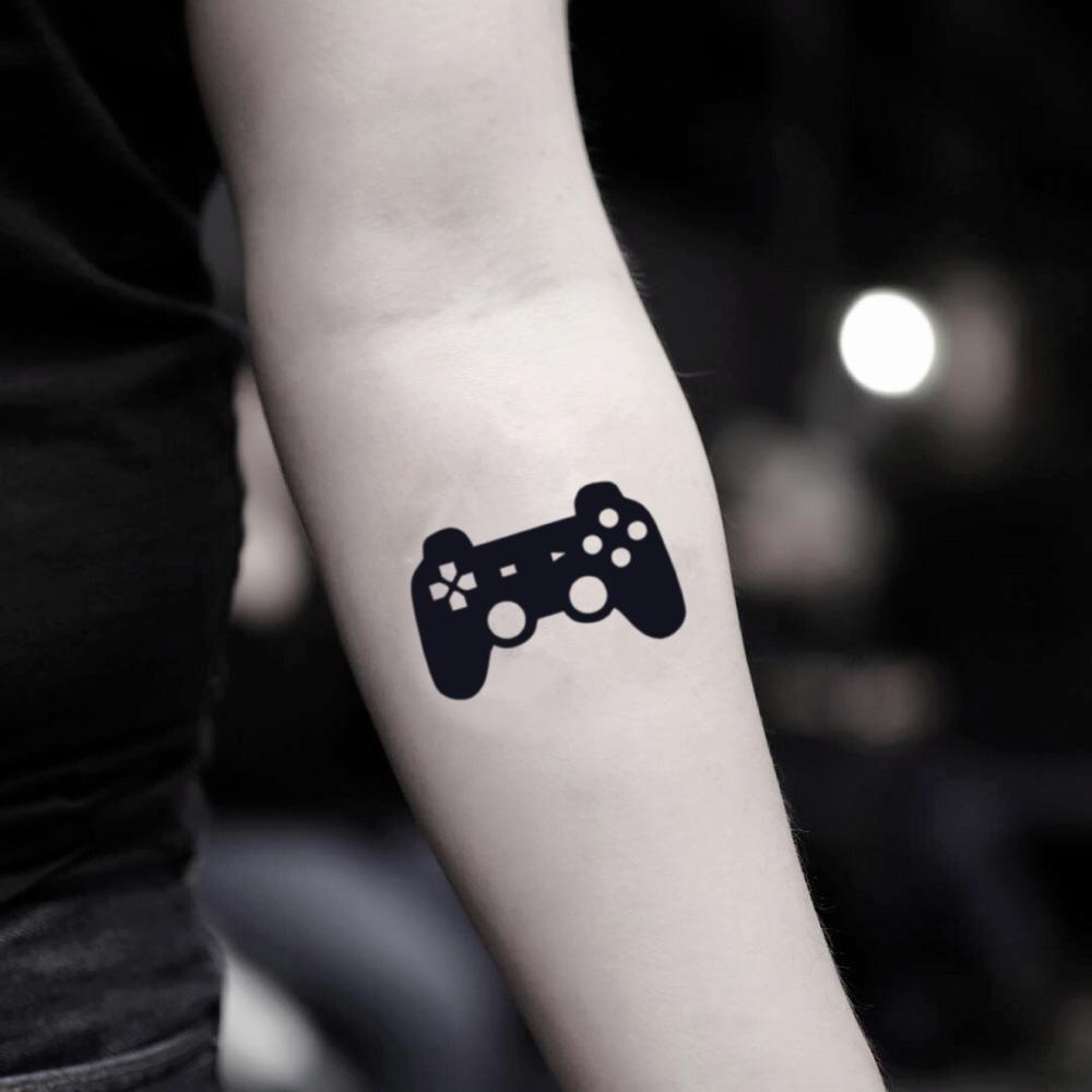 fake small video game gamer control nintendo playstation ps4 xbox controller illustrative temporary tattoo sticker design idea on inner arm