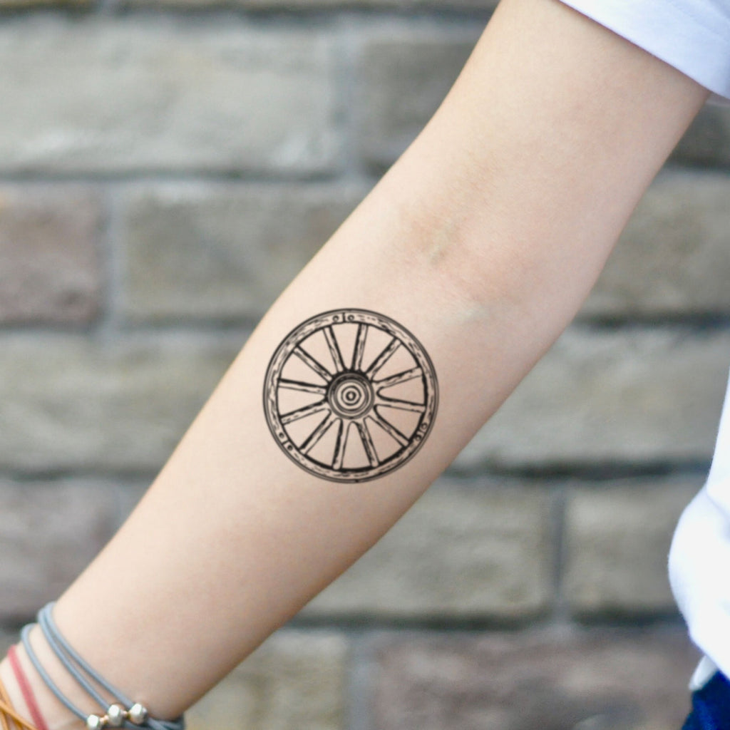 fake small wagon wheel old school simple vintage geometric temporary tattoo sticker design idea on inner arm