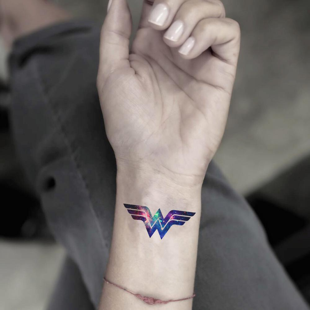 fake small wonder woman color temporary tattoo sticker design idea on wrist