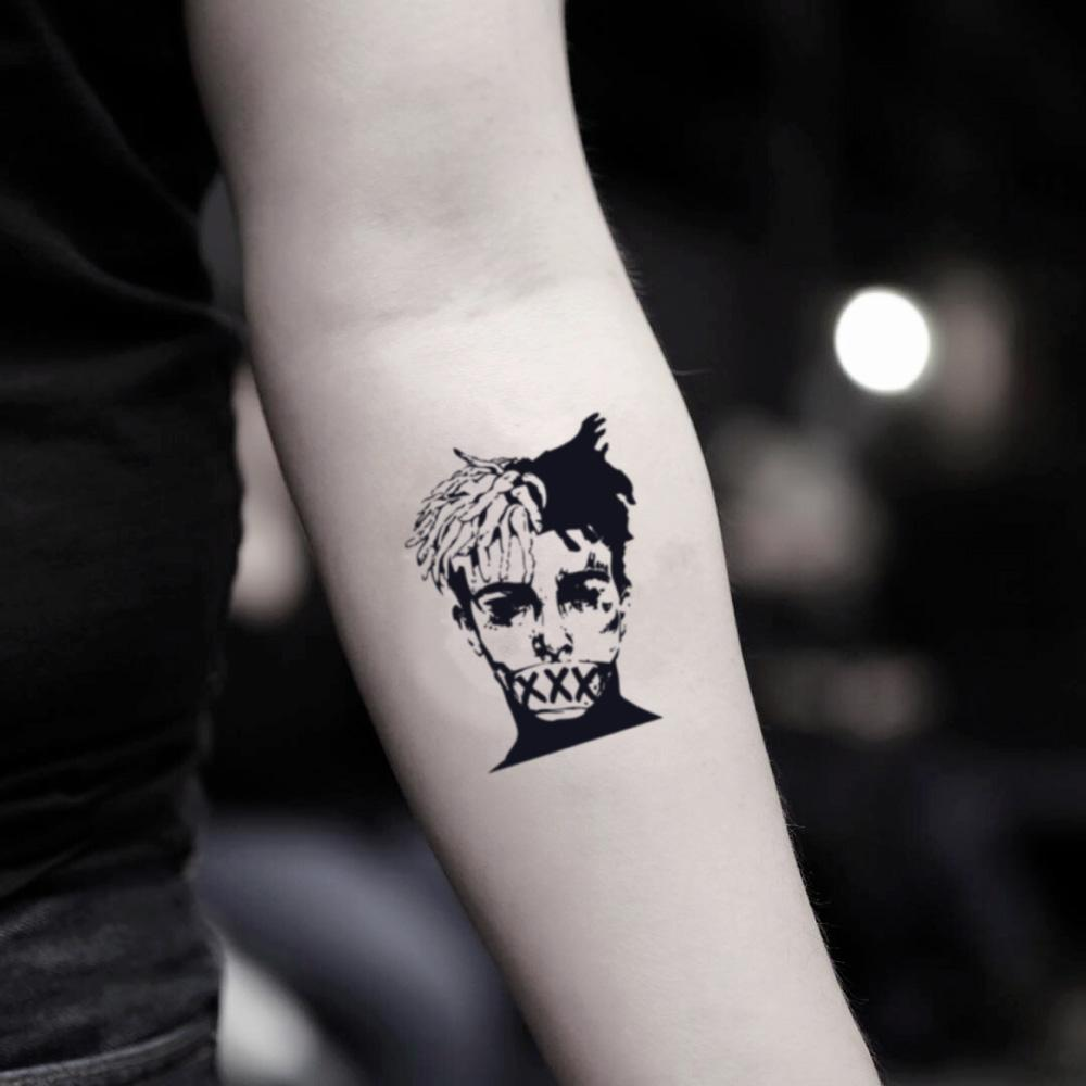 fake small xxxtentacion portrait temporary tattoo sticker design idea on inner arm