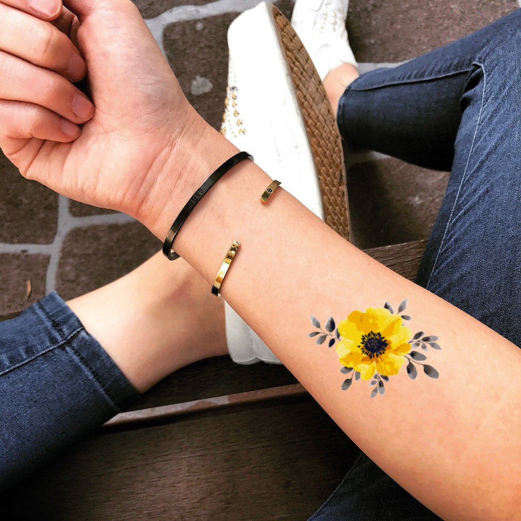 fake small yellow flower color temporary tattoo sticker design idea on forearm
