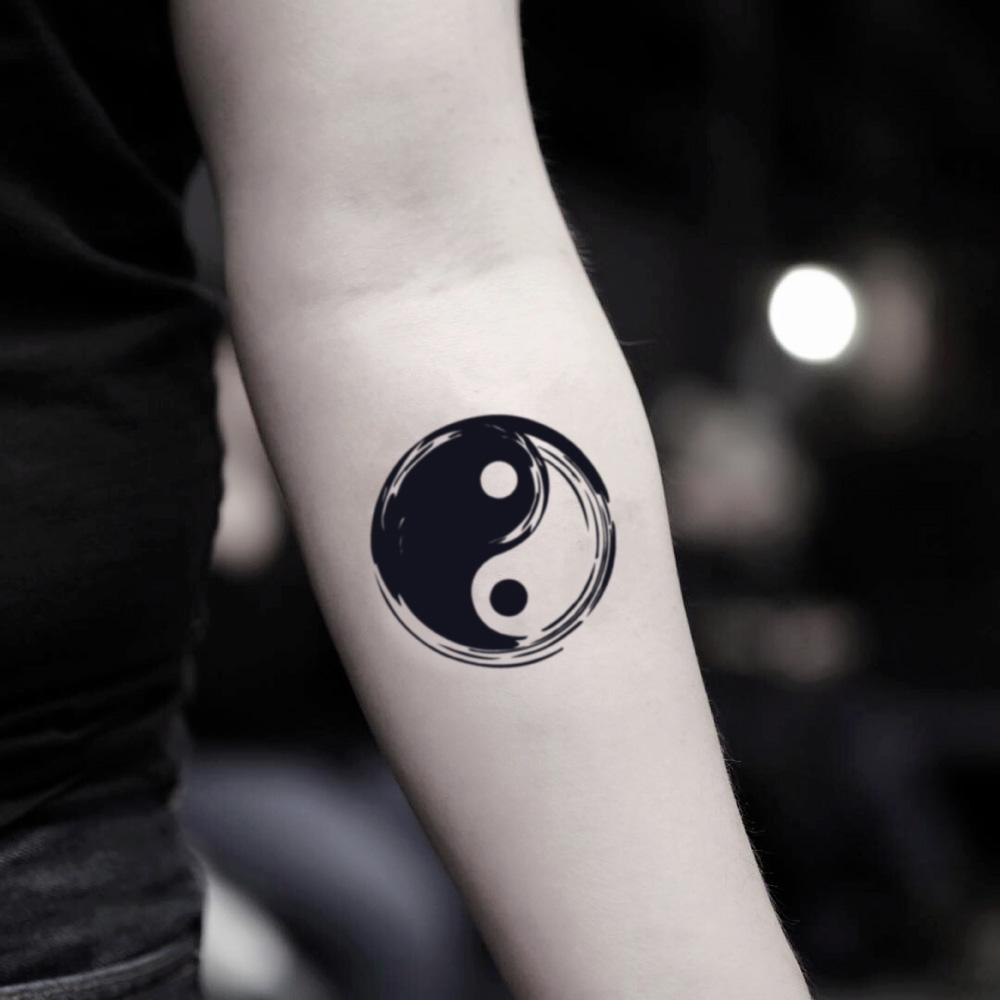 fake small bold yin yang illustrative temporary tattoo sticker design idea on inner arm