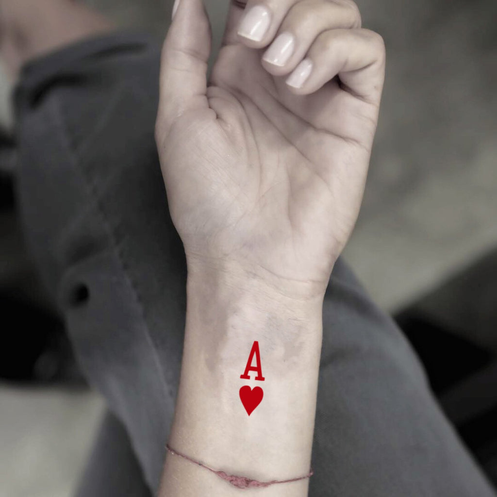 fake tiny ace of hearts color minimalist temporary tattoo sticker design idea on wrist