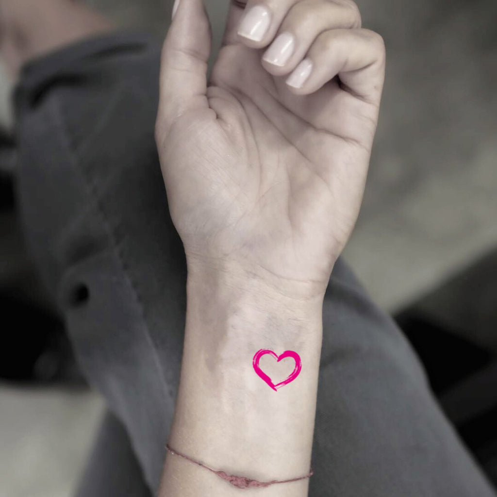 fake tiny pink heart color minimalist temporary tattoo sticker design idea on wrist