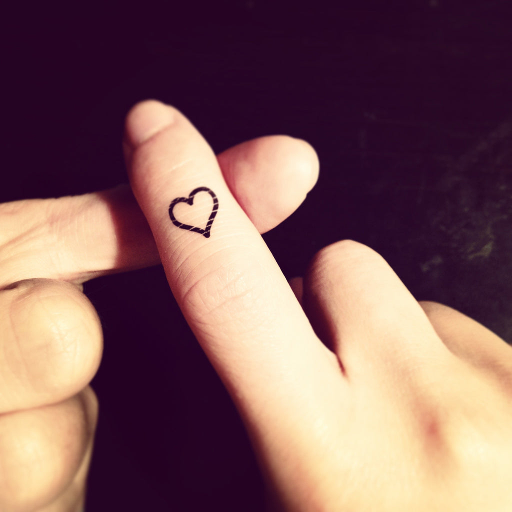 fake tiny small heart outline minimalist temporary tattoo sticker design idea on finger