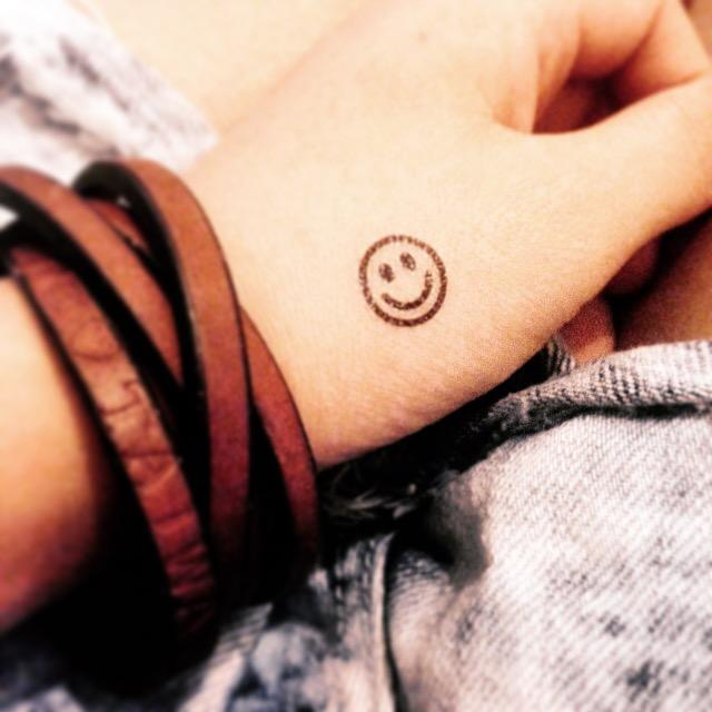 fake tiny smiley symbol minimalist temporary tattoo sticker design idea on wrist