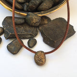The Coffee Bean!  Bronze beach stone on leather cord with a bronze clasp.