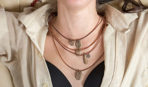 Rivited - Bronze beach stone necklace on leather cord... Our first & best selling!