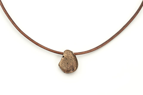 Manzanita... Bronze beach stone on leather cord with bronze clasp