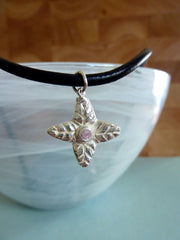 Four leaf flower with pale pink cubic zirconia