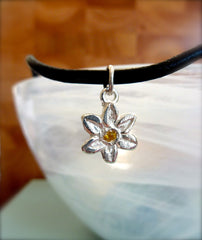 Miniature flower with yellow cubic zirconia accent