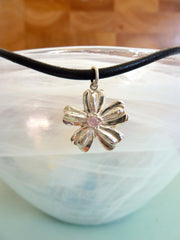 Flower with pink cubic zirconia accent