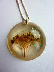 Dried flower in resin with glitter