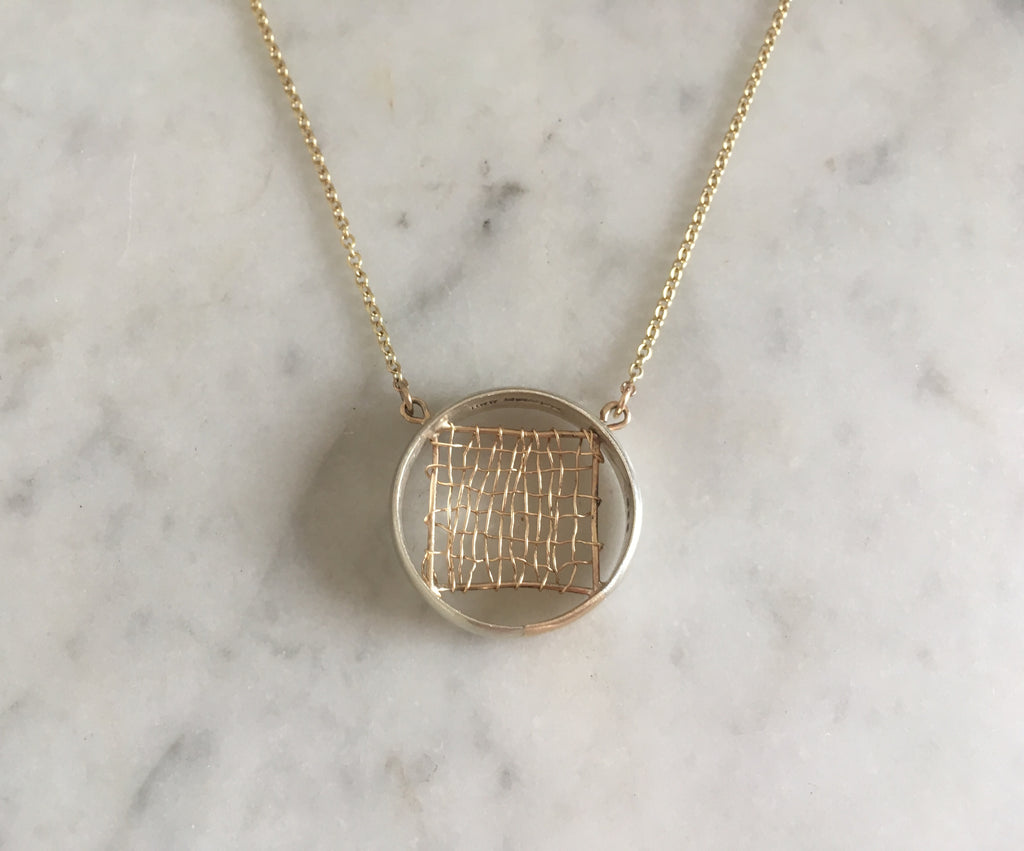 late husband's wedding ring made into a necklace with gold woven detail