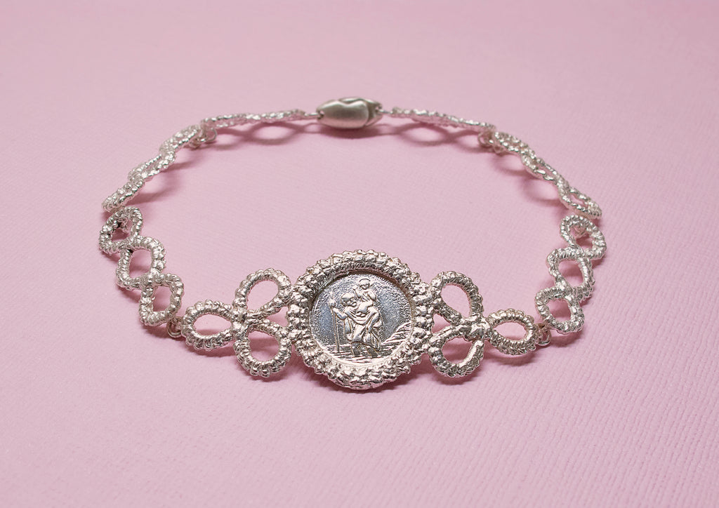 Silver lace bracelet featuring St Christopher charm