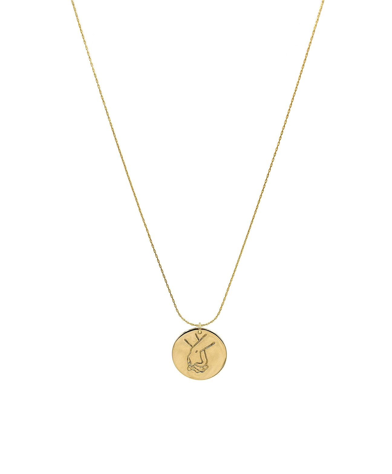The Sign Circle Coin Necklace in Holding Hands