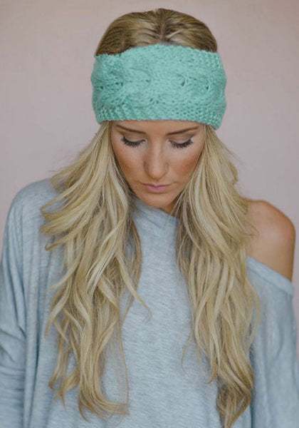Front view of model in mint green crochet headwrap
