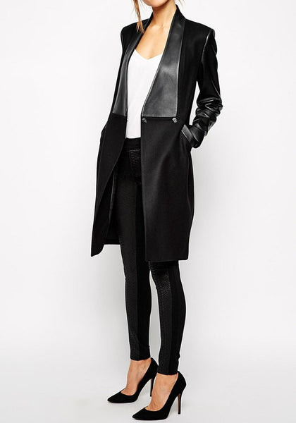 Full_front_view_of_girl_in_black_PU_leather_sleeve_coat