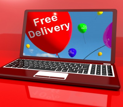 image of a laptop with free delivery text on screen